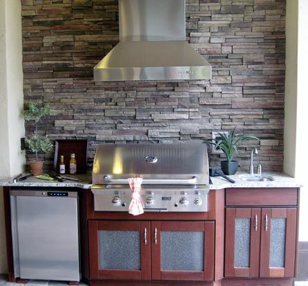 Lifestyle outdoor cabinets with stacked stone by Lifestyle Outdoor Kitchens